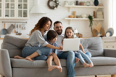 bigstock-Happy-Family-With-Kids-Sit-On--353463041